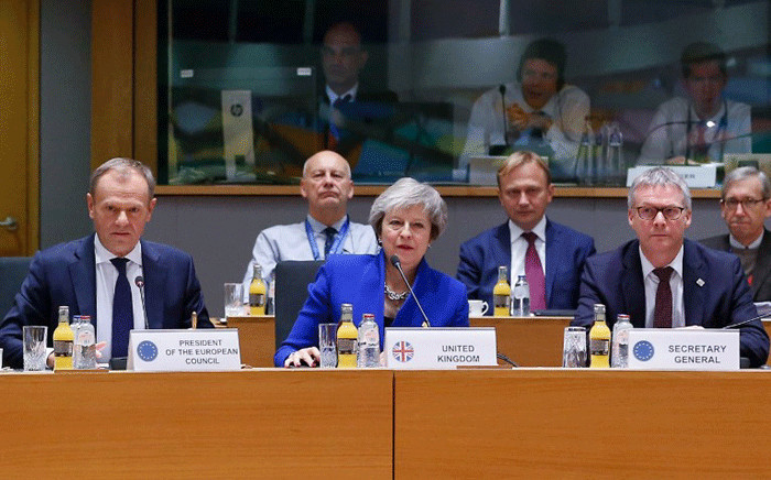 Britain's Prime Minister Theresa May (C) and European Council President Donald Tusk (L) attend a special meeting of the European Council to endorse the draft Brexit withdrawal agreement and to approve the draft political declaration on future EU-UK relations on November 25, 2018 in Brussels. Picture: AFP.
