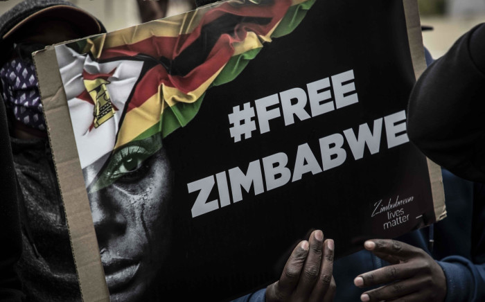 Not in my Name organisation and Zimbabwean citizens attempted to protest outside the Zimbabwean embassy in Pretoria in solidarity with the #ZimbabweanLivesMatter movement but were forced to disperse by police with rubber bullets and stun grenades after being told they are not allowed to gather. Picture: Abigail Javier/EWN