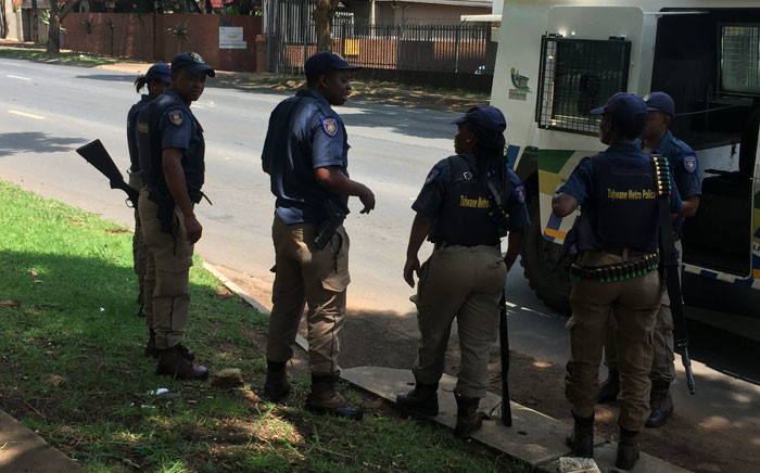 Police stand guard outside the Democratic Republic of Congo embassy in Pretoria during protests calling on DRC President Joseph Kabila to step down. Picture: Pelane Phakgadi/EWN.