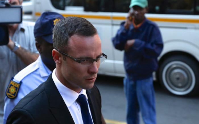 Oscar Pistorius is escorted into High Court in Pretoria ahead of his murder trial on 17 March 2014. Picture: Aletta Gardner/EWN.