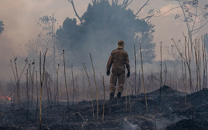 Handout picture released by the Communication Department of the State of Mato Grosso showing a firefighter combating a fire in the Amazon basin in the municipality Sorriso, Mato Grosso State, Brazil, on 26 August 2019. Picture: AFP
