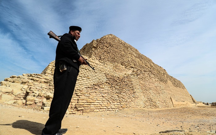 A policeman stands guard near the step pyramid of Djoser in Egypt's Saqqara necropolis, south of the capital Cairo, on March 5, 2020. Picture: AFP.