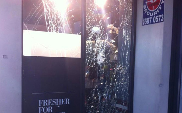 Several shops were damaged after an explosion outside Woolworths at Kromboom Centre in Crawford on 5 September 2014. Picture: Carmel Loggenberg/EWN