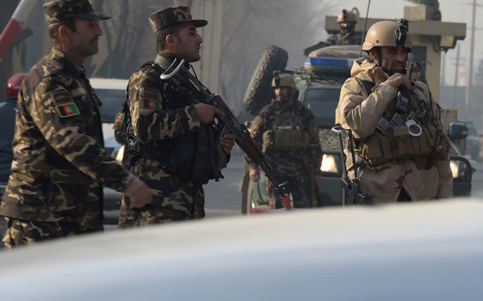Afghan security personnel block a road near the site of a suicide attack in Kabul on 25 December, 2017. Picture: AFP