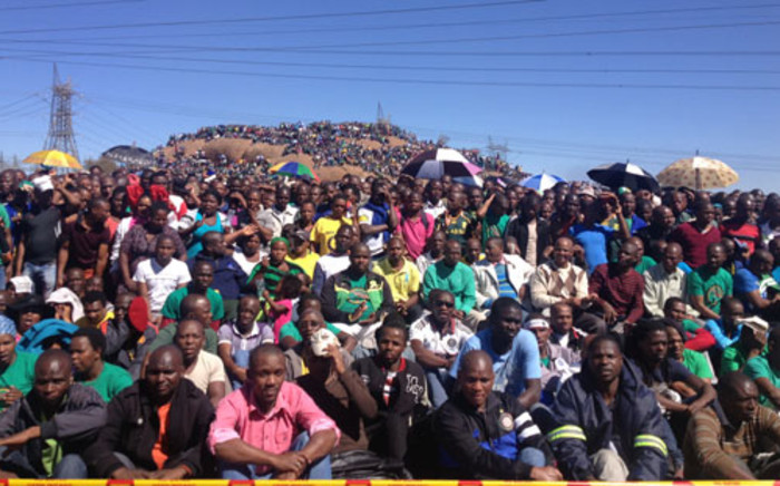 Lonmin miners during the one year anniversary at Lonmin's Marikana mine where 34 striking platinum workers were shot dead by police on 16 August 2012. Picture: Christa Van der Walt/EWN.