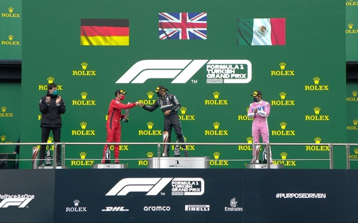 Mercedes' British driver Lewis Hamilton (centre) celebrates on the podium after winning the Turkish Formula One Grand Prix at the Intercity Istanbul Park circuit in Istanbul on 15 November 2020. Picture: @F1/Twitter