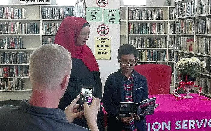 Amr Salie reads from his first book, 'Blameless' during the launch at the Lansdowne library. Picture: facebook.com