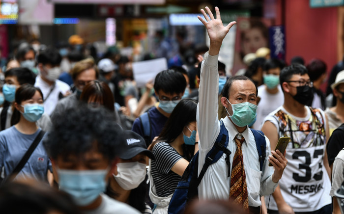 FILE: Protesters march on a road during a pro-democracy rally against a proposed new security law in Hong Kong on 24 May 2020. Picture: AFP
