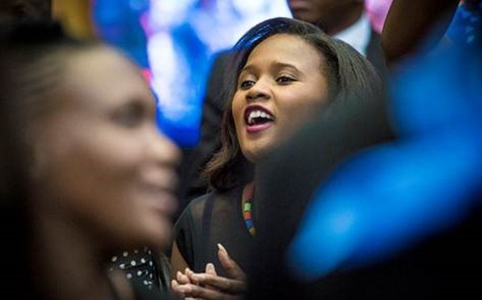 A young woman sings in anticipation of President Zuma and President Robert Mugabe at the University of Fort Hare on 20 May 2016. Picture: Thomas Holder/EWN.