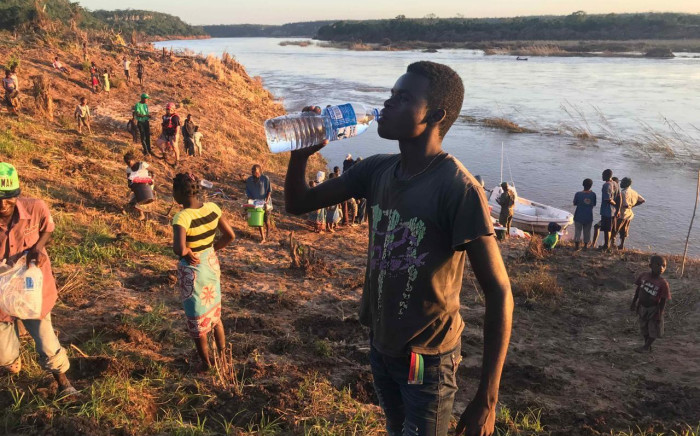 A man from a village close to the edge of the Buzi River drinks water after receiving food and water from relief workers after Cyclone Idai hit Mozambique. Picture: Christa Eybers/EWN.
