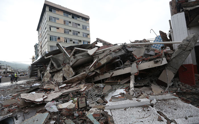 View of rubble after a 7.8-magnitude quake in Portoviejo, Ecuador on 17 April, 2016. Hundreds of people were killed when a powerful earthquake struck Ecuador, destroying buildings and a bridge and sending terrified residents scrambling from their homes, authorities said Sunday. Picture: AFP.