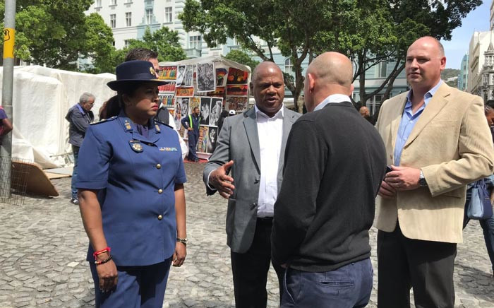 Cape Town Mayor Dan Plato and Cape Town Central Police Station commander Brigadier Hansia Hansraj speak with business owners at Green Market Square during a walkabout in the City Centre. Picture: Kevin Brandt/EWN