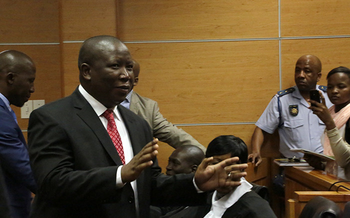 Julius Malema greeted the media as he entered court during the second day of his fraud and corruption trial in Polokwane. Picture: Reinart Toerien/EWN.