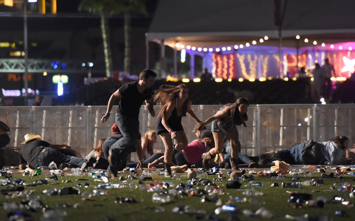 FILE: People run from the Route 91 Harvest country music festival after apparent gun fire was heard on 1 October 2017 in Las Vegas, Nevada. Picture: AFP