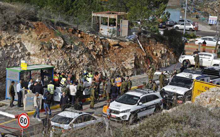 Israeli forces and forensic experts inspect the site of a Palestinian drive-by shooting attack outside the West Bank settlement of Givat Asaf, northeast of Ramallah, on 13 December 2018. Picture: AFP