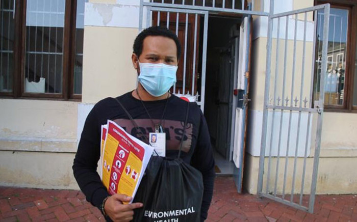 Armed with his coronavirus information pamphlets, City of Cape Town environmental health practitioner Ziyaad Samaai gets ready to do his rounds in his district. Picture: Kaylynn Palm/EWN
