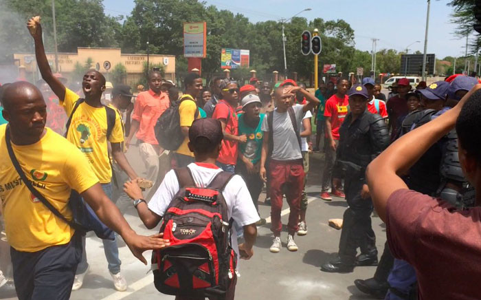 FILE: Students clash with police during demonstrations over the use of Afrikaans at the University of Pretoria. Picture: EWN.