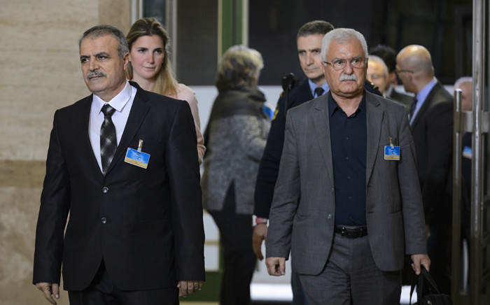 Members of the Syria's main opposition group Head of the Delegation Asaad Zoabi (L) and Deputy Head George Sabra (R) arrive to attend Syrian peace talks at the United Nations (UN) Offices in Geneva on 1 February, 2016. Picture: AFP.