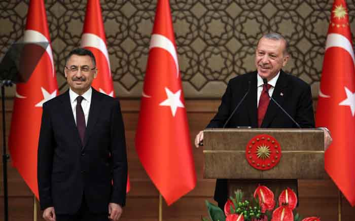 Turkey's President Recep Tayyip Erdogan (R) and Vice President Fuat Oktay (L) during a news conference at the Presidential Palace in Ankara, on 9 July 2018. Picture: AFP