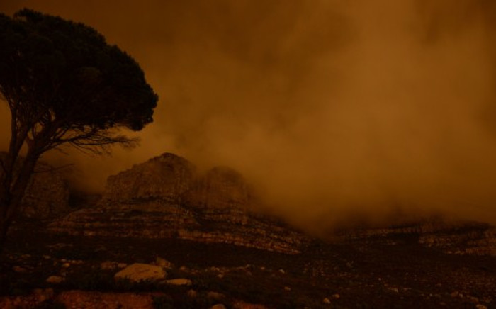 Table Mountain is plunged into darkness for the global Earth Hour initiative on 29 March. Picture: AFP.