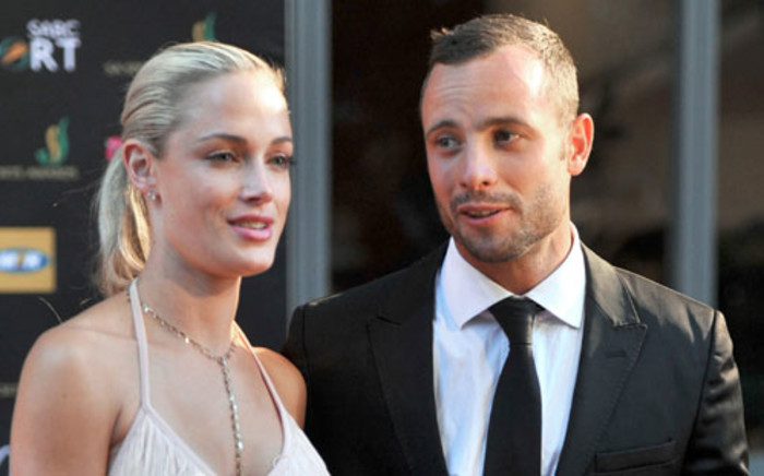 Oscar Pistorius and his girlfriend Reeva Steenkamp at the Feather Awardson 4 November 2012. Picture: AFP.