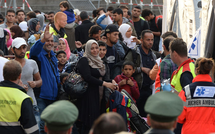 FILE: Incoming refugees wait for a medical check after their arrival in front of the main train station in Munich, Germany in September 2015. Picture: AFP