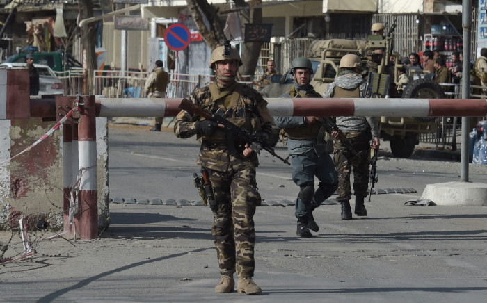 FILE: Afghan security personnel arrive at a site following an explosion. Picture: AFP