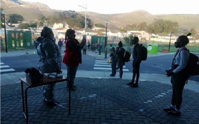 Grade 7 pupils at Westlake Primary School in the Western Cape on 1 June 2020 line up for screening before they enter the school. Picture: @WCEDnews/Twitter.