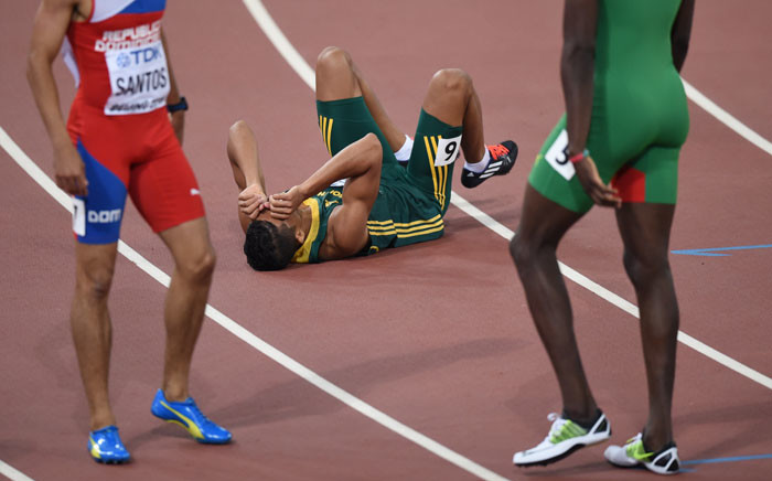 """FILE: South Africa's Wayde Van Niekerk reacts after winning the final of the men's 400 metres athletics event at the 2015 IAAF World Championships at the """"Bird's Nest"""" National Stadium in Beijing on 26 August, 2015. Picture: AFP"""