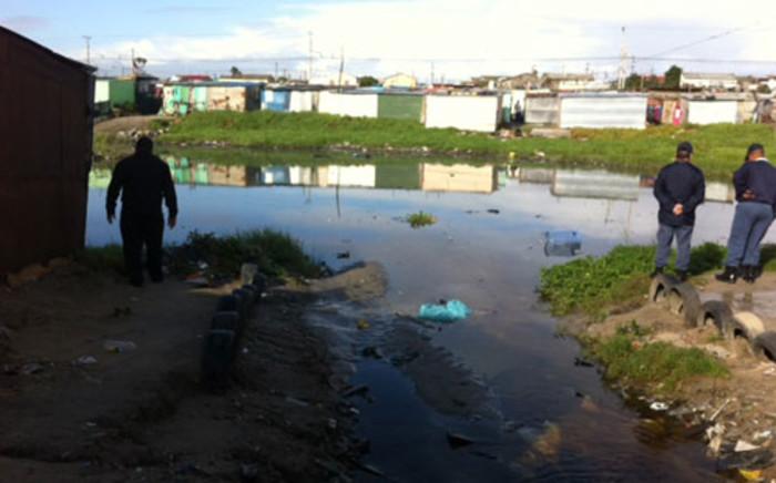 Police assess flood damage in Khayelitsha, Cape Town after heavy rains. Picture: Rahima Essop/EWN