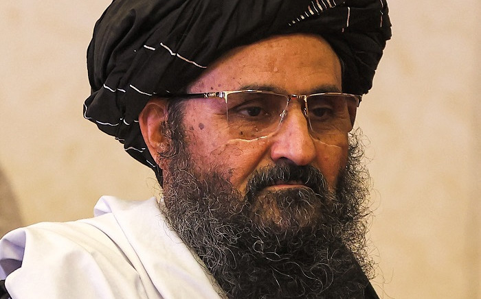FILES: In this file photo taken on July 18, 2021 The leader of the Taliban negotiating team Mullah Abdul Ghani Baradar walks after the final declaration of the peace talks between the Afghan government and the Taliban in Qatar's capital Doha. Karim Jaafar / AFP.