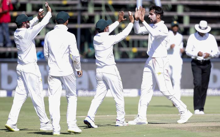 FILE: Pakistan's bowler Mohammad Amir (2nd R) celebrates the dismissal of South Africa's batsman Zubayr Hamza (unseen) during the first day of the third Cricket Test match between South Africa and Pakistan at Wanderers Cricket Stadium in Johannesburg on 11 January 2019. Picture: AFP