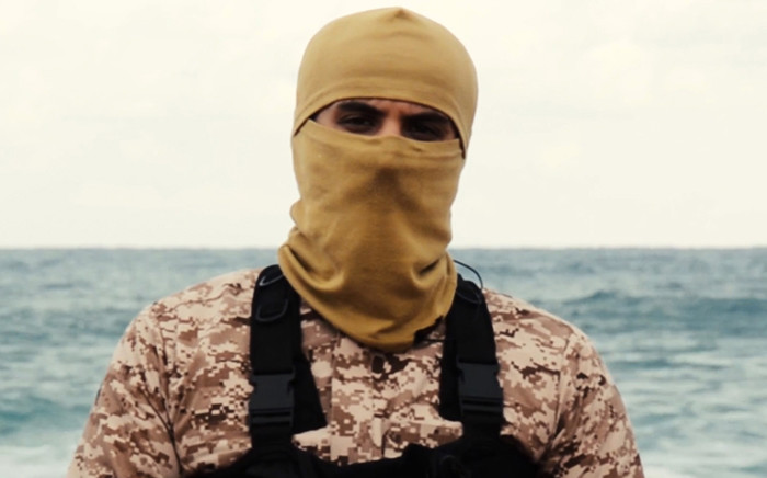 A file image grab taken from a video released by the jihadist media arm Al-Hayat Media Centre on February 15, 2015, purportedly shows a man the Pentagon believes to be Abu Nabil, also known as Wissam Najm Abd Zayd al Zubaydi, who was killed in an air strike in Libya overnight on November 14. The image grab shows Abu Nabil speaking after leading handcuffed hostages, said to be Egyptian Coptic Christians, wearing orange jumpsuits before their alleged decapitation on a seashore in the Libyan capital of Tripoli. Picture: AFP.