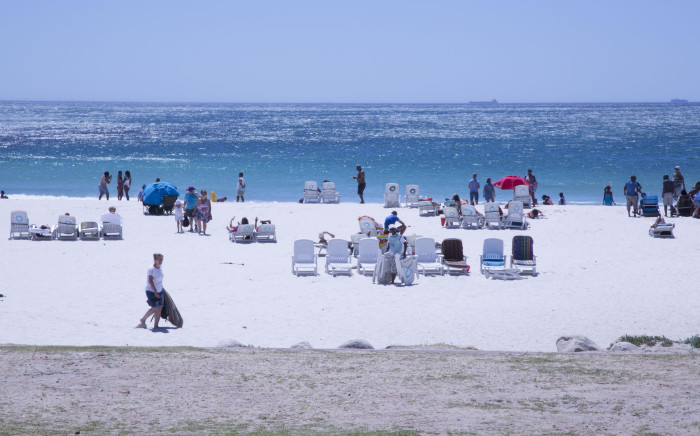 Beachgoers flocked to Cape Town's Camps Bay beach to make the most of December's scorching temperatures.