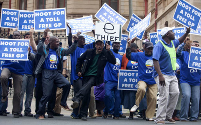 Democratic Alliance supporters voice their disapproval over the e-tolling system outside the North Gauteng High Court in Pretoria on Tuesday, 24 April 2012 where the system is being challenged. Picture:Sapa.