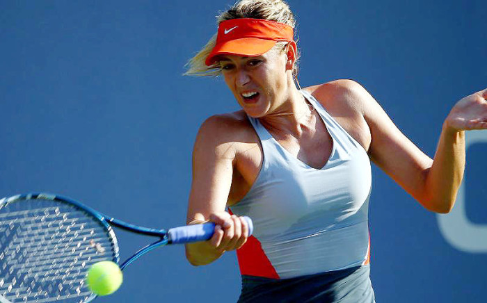 FILE. Maria Sharapova hits the ball during the US Open on 28 August 2014. Picture: @USOpen