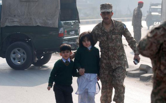FILE: Pakistani police and military take school children to the place of safety after six gunmen entered the school and held over 500 children hostage on 16 December 2014. Picture: NDTV @ndtv.