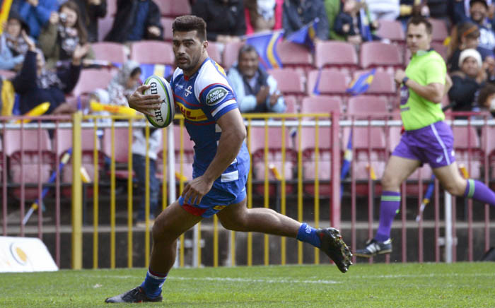 Stormers' Damien de Allende runs to score a try during the Super Rugby rugby union match between South Africa's Stormers and Australia's Rebels on 27 April 2018, at Newlands Stadium in Cape Town. Picture: AFP.