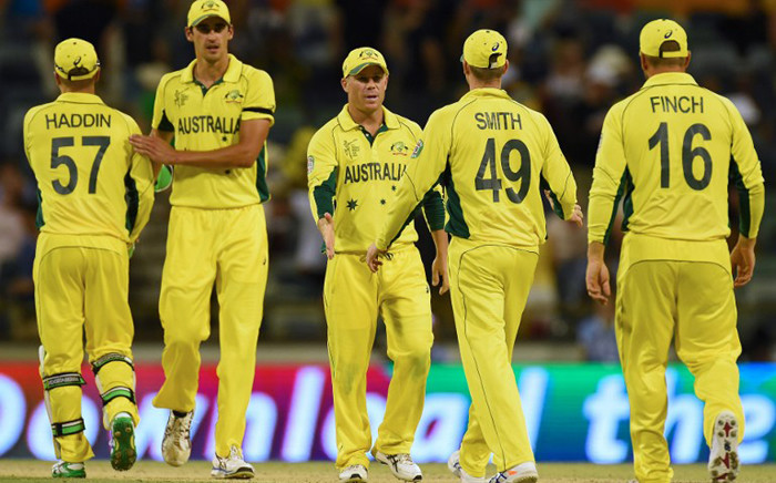 FILE: The Australian team leaves the ground after defeating Afghanistan in the 2015 Cricket World Cup Pool A match in Perth on 4 March, 2015. Picture: AFP