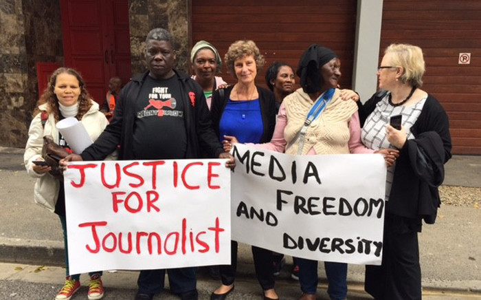 Activists and journalists standing outside the Labour Court in Cape Town after Former Cape Times Editor Alide Dasnois reached a settlement with the Independent Media Group following a three-year legal tussle on 9 May 2016. Picture: Natalie Malgas/EWN.