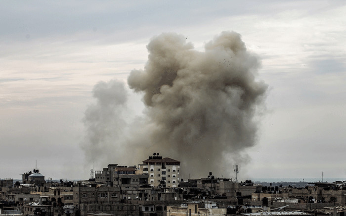 A picture taken on 15 February 2018 from the western Gaza strip border town of Rafah in shows a smoke plume rising on the Egyptian side of the border following an explosion. Picture: AFP.
