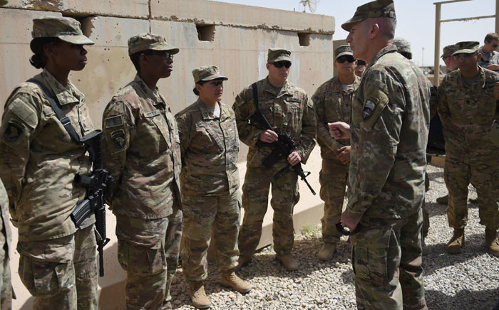 FILE: The US commander in Afghanistan John Nicholson (R) talks with soldiers in the Afghan province of Helmand on 29 April 2017. Picture: AFP