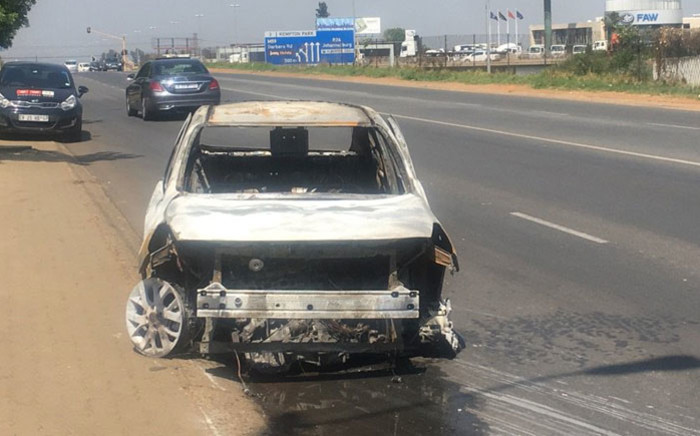 The wreckage of an Uber vehicle after it was torched during protest near Kempton Park on 27 October 2017. Picture: Mia Lindeque/EWN