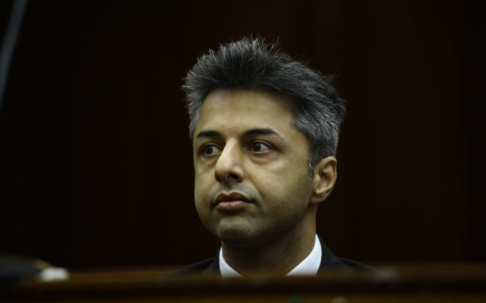 British businessman Shrien Dewani sits during proceedings in the Western Cape High Court during his murder trial on 6 October 2014. Picture: Aletta Gardner/EWN.