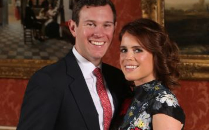 FILE: Britain's Princess Eugenie of York poses with her fiancé Jack Brooksbank at Buckingham Palace in London on 22 January 2018 after the announcement of their engagement. Picture: Jonathan Brady/POOL/AFP