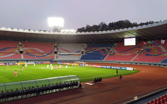 This handout photo taken on October 15, 2019 by the Korea Football Association (KFA) shows empty stands during the World Cup 2022 Qualifying Asian zone Group H football match between South Korea (in white) and North Korea at Kim Il Sung Stadium in Pyongyang. Picture: AFP/KFA.
