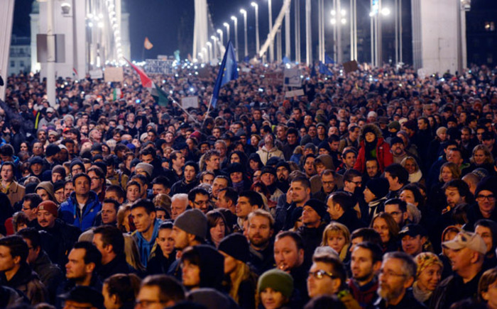 Thousands of demonstrators march through Elizabeth Bridge across River Danube as they protest against an internet tax planned to be introduced by the Hungarian government. Picture: EPA.