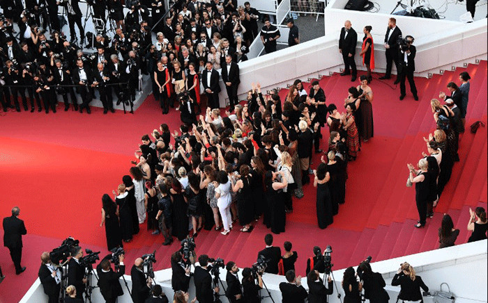 Filmmakers, actresses and producers listen to Australian actress and President of the Jury Cate Blanchett read a statement on the red carpet in protest of the lack of female filmmakers honoured throughout the history of the festival at the screening of 'Girls Of The Sun (Les Filles Du Soleil)' during the 71st annual Cannes Film Festival at the Palais des Festivals on 12 May 2018 in Cannes, southeastern France. Picture: AFP.