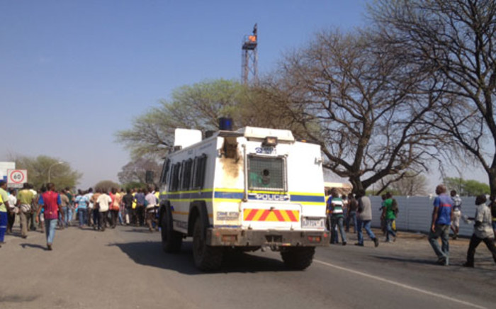 A police nyala monitors miners. Picture:Govan Whittles/EWN