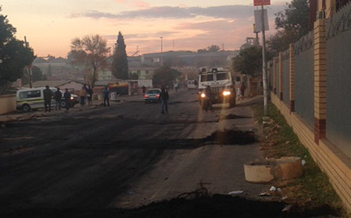 Police and the military have been deployed to monitor the situation in Alexandra after residents set alight the offices of the ANC councillor and a local clinic during overnight protests on 8 May 2014. Picture: Mia Lindeque/EWN.